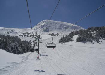 Ski lift in the mountains with lots of snow