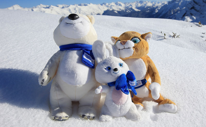 The Sochi mascots sitting in the snow