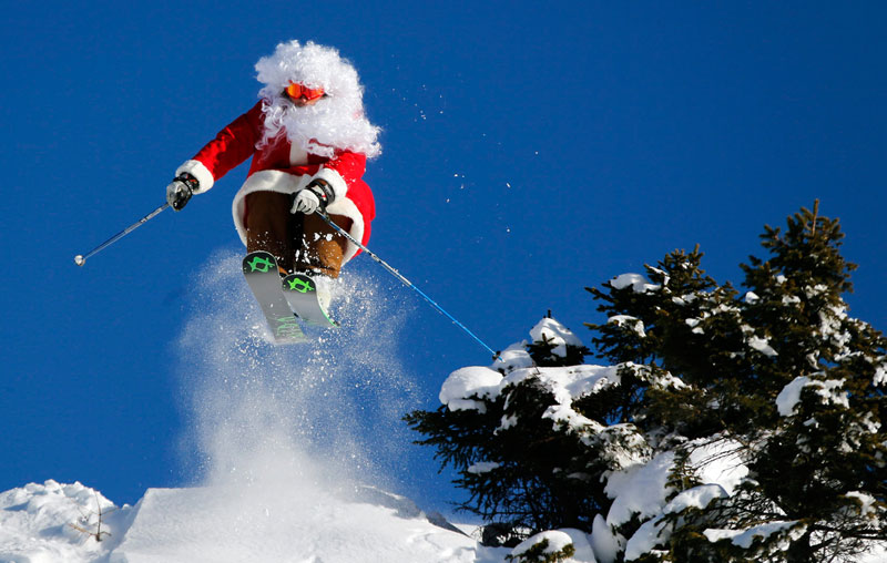 Santa on skis doing a jump
