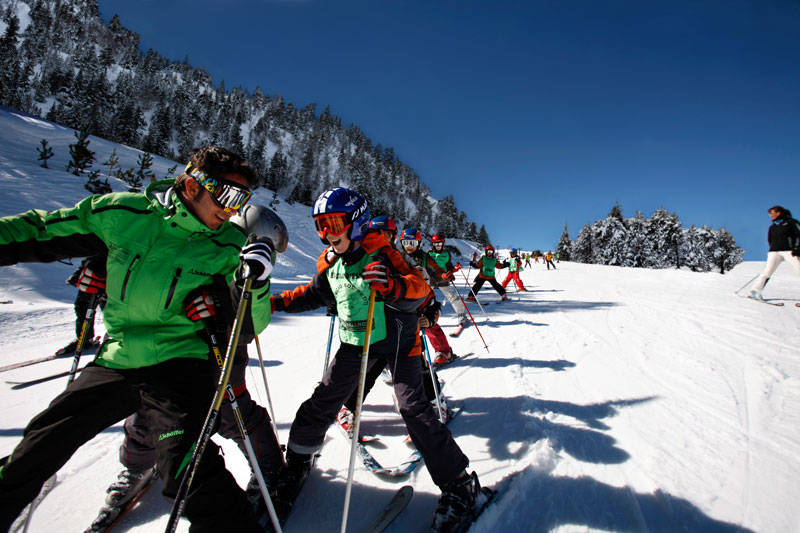 Vallnord ski instructor with a childrens ski school group