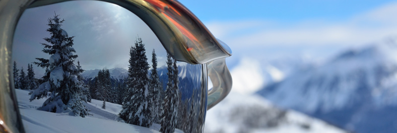 Ski goggles looking over mountains