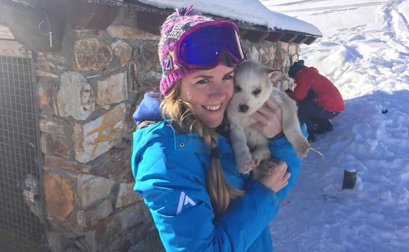 Sofia with a husky puppy