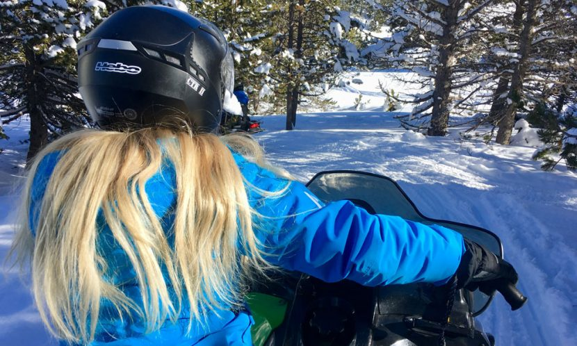 Girl on snowmobile